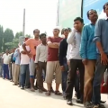 people in queue for money