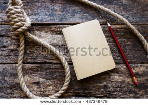 stock-photo-running-knot-and-a-suicide-note-on-a-wooden-background-437349478