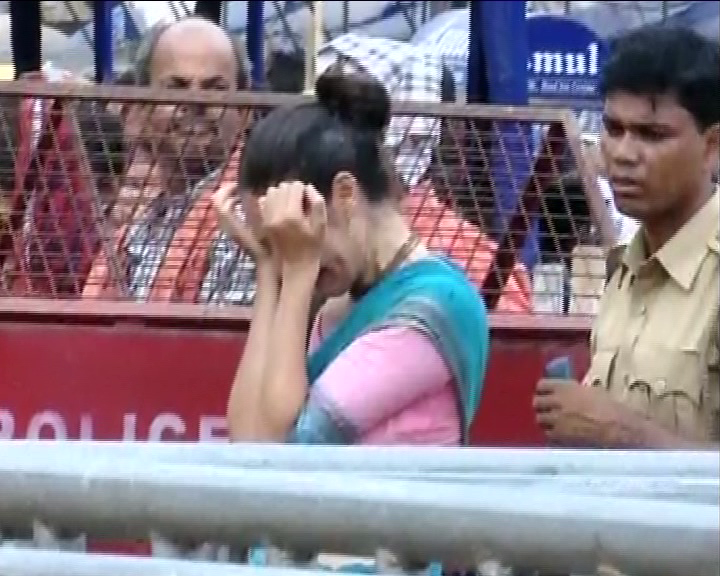 devotee crying in front of jagannath temple