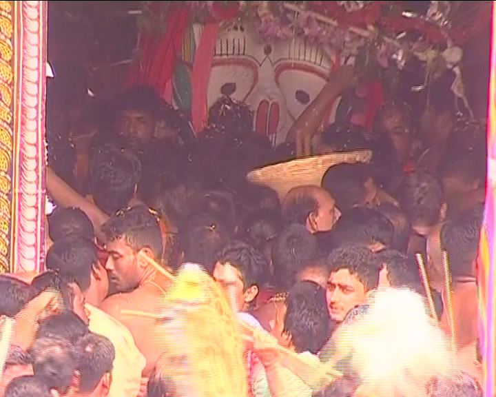 Devotees touch deities during Ratha Yatra