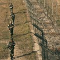 Indian BSF soldiers patrol near the fenced border with Pakistan in Suchetgarh
