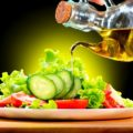 Healthy Vegetable Salad with Olive oil dressing. Pouring Olive o