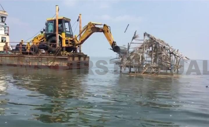 bulldozer hits illegal prawn farm