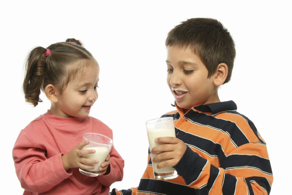 Brother and sister drinking milk