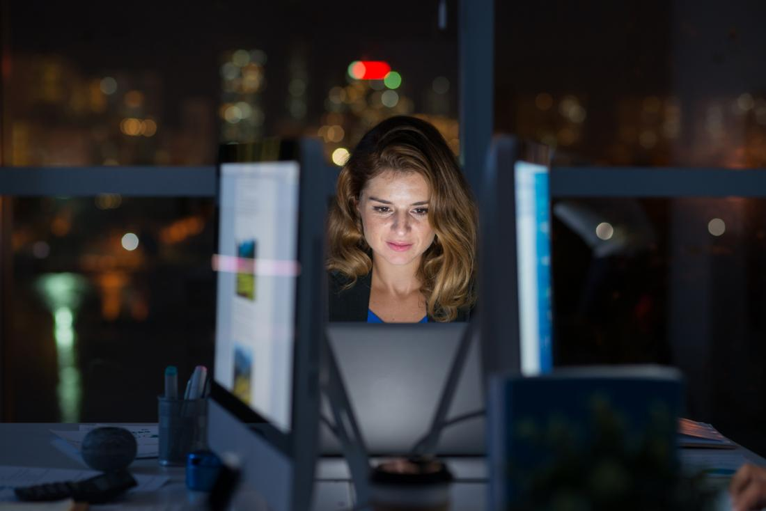 woman-working-at-her-computer-at-night