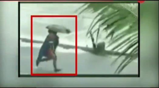 dramatic-video-rescue-officer-running-child-through-flooding-kerala-bridge
