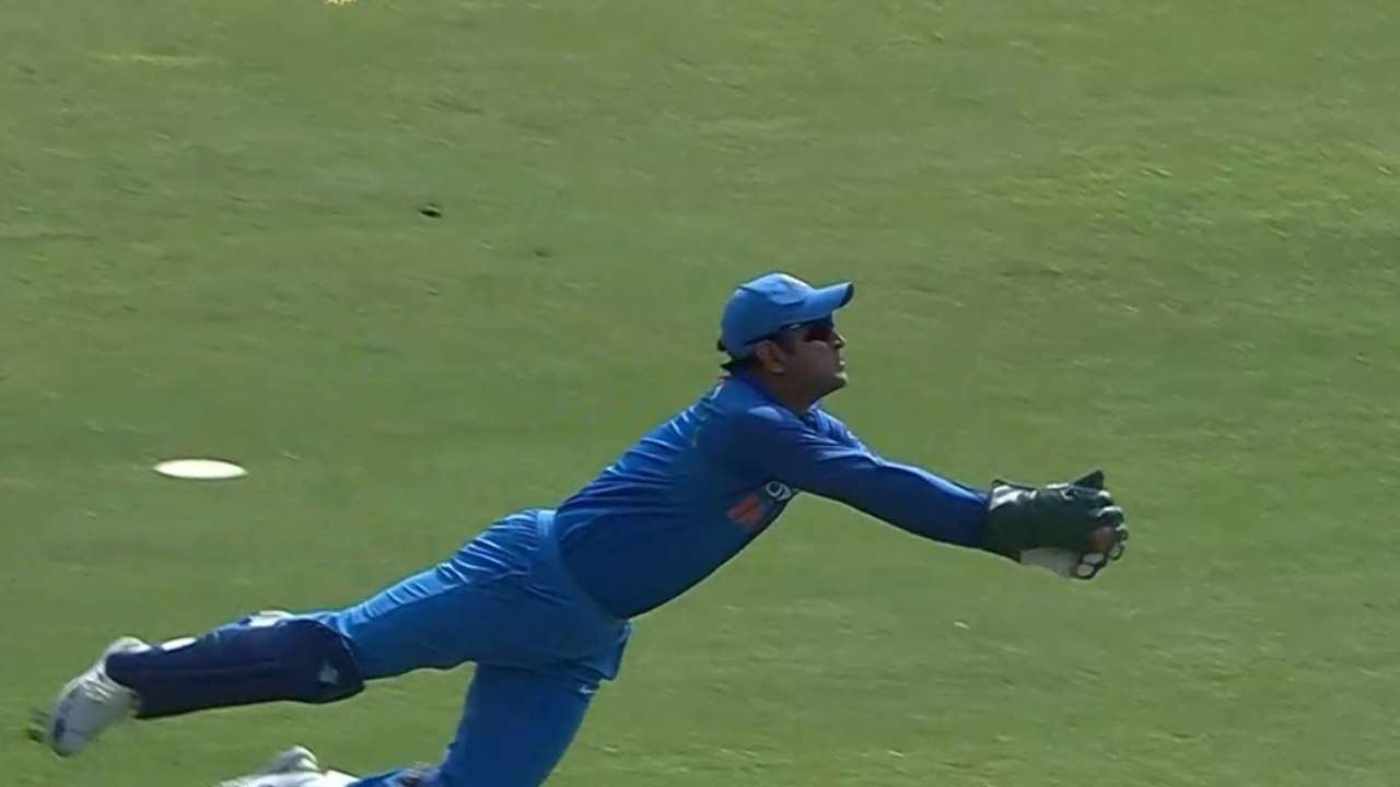 748268-dhoni-diving-catch-twitter