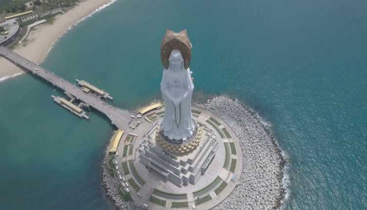 forward-flying-tilting-down-video-of-a-tall-white-buddha-statue-known-as-guan-yin-part-of-the-nanshan-temple-complex-located-on-hainan-island-in-the-south-china-sea_rpxq5v2a_thumbnail-full01