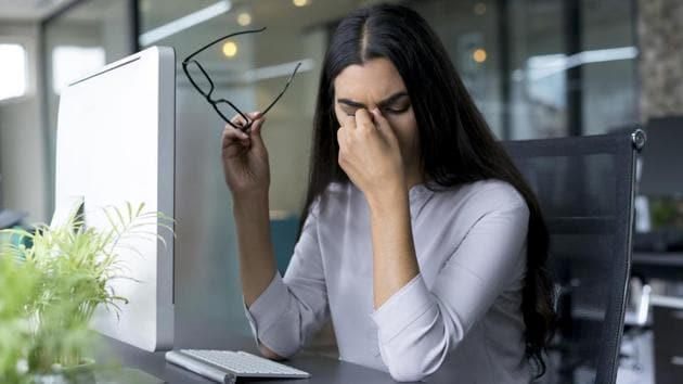 depressed-businesswoman-rubbing-eyes-in-office_f2502d42-5f1d-11e8-828c-aa2fd3852b8f