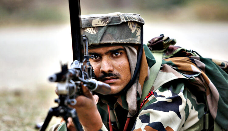 An Indian Army soldier takes position during an encounter with a